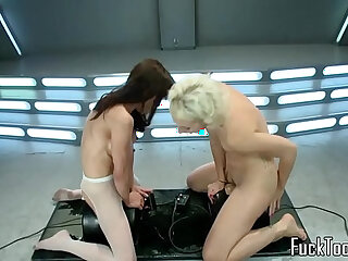 Squirting lesbian pussy toyed by machine