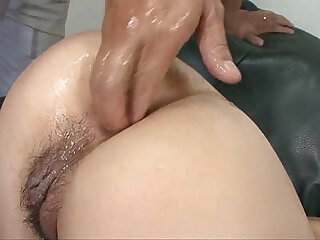 Japanese babe Arisa has her ass stuffed with fingers and a vibrator