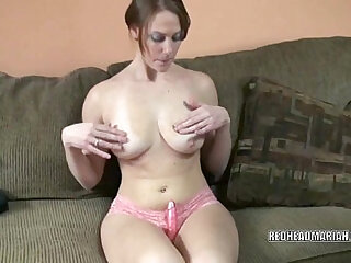 Busty girl fucks her twat with a dildo