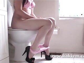 Pink shorts pooping girl