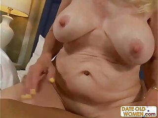 Blonde grandmother on the floor sucking cock